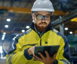 an industrial worker uses a tablet
